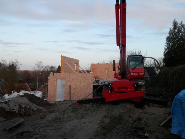 Pose et élévation des panneaux ossature bois